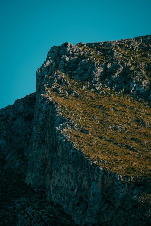 Cliff Under Blue Sky