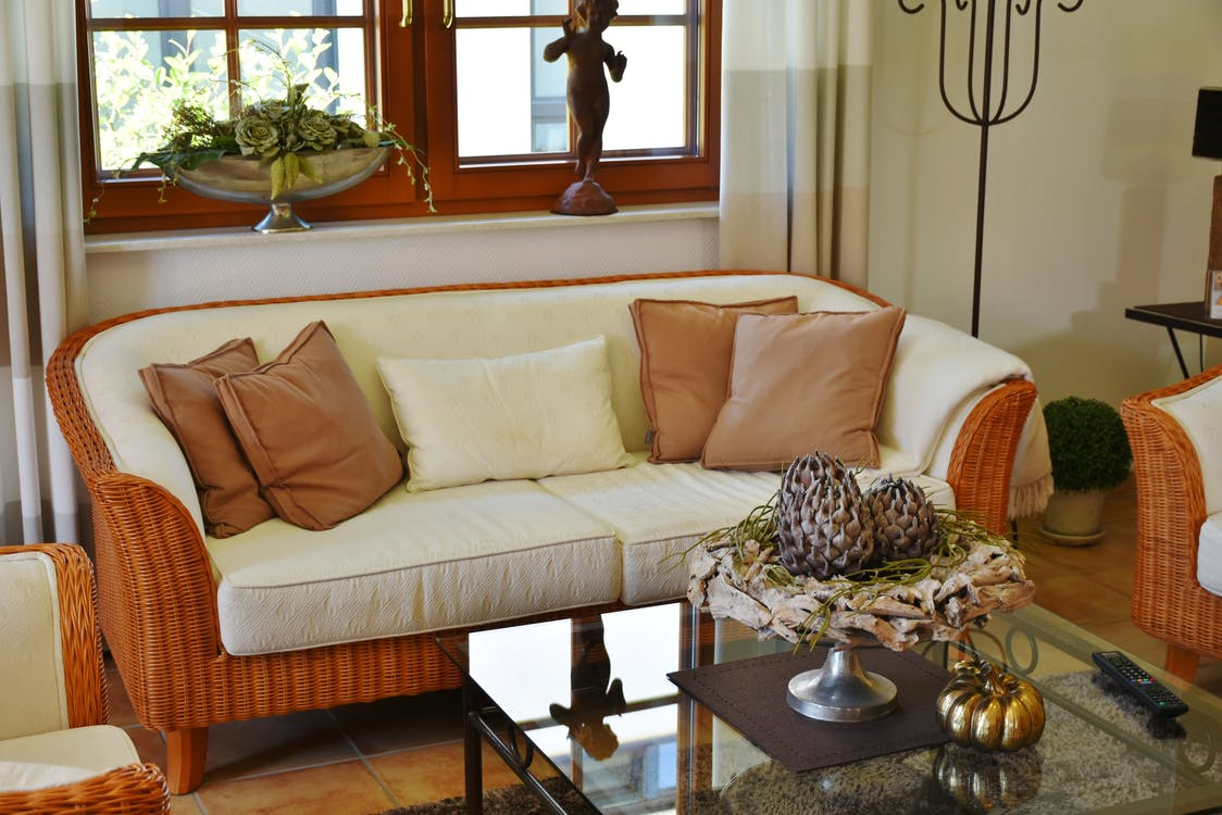 White Suede Loveseat With Brown Wicker Base