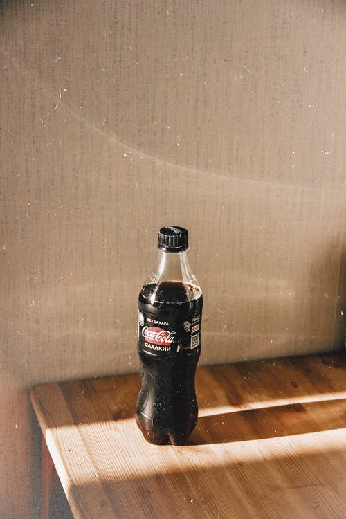 Photo of Coca-cola Bottle on Wooden Table