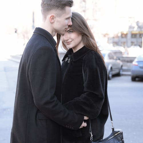 Photo of Couple Wearing Coat
