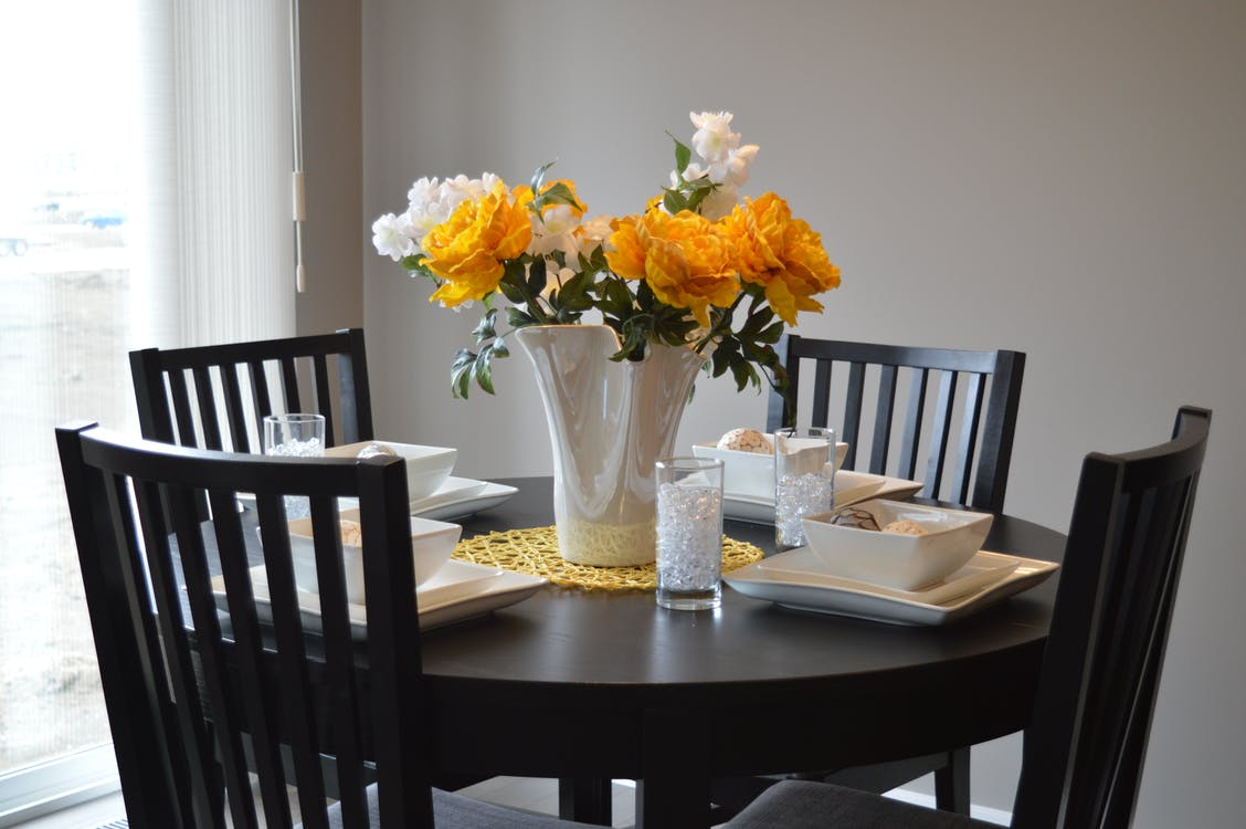 White Ceramic Vase on Dining Table