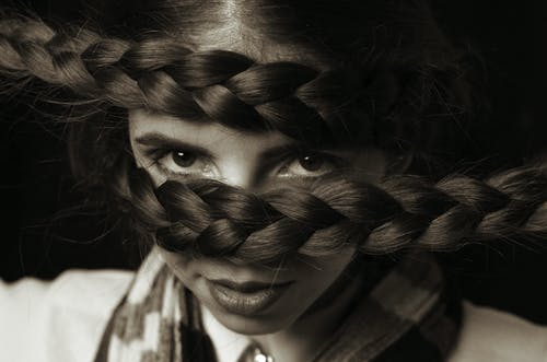 Monochrome Photo of Woman With Braided Hairstyle