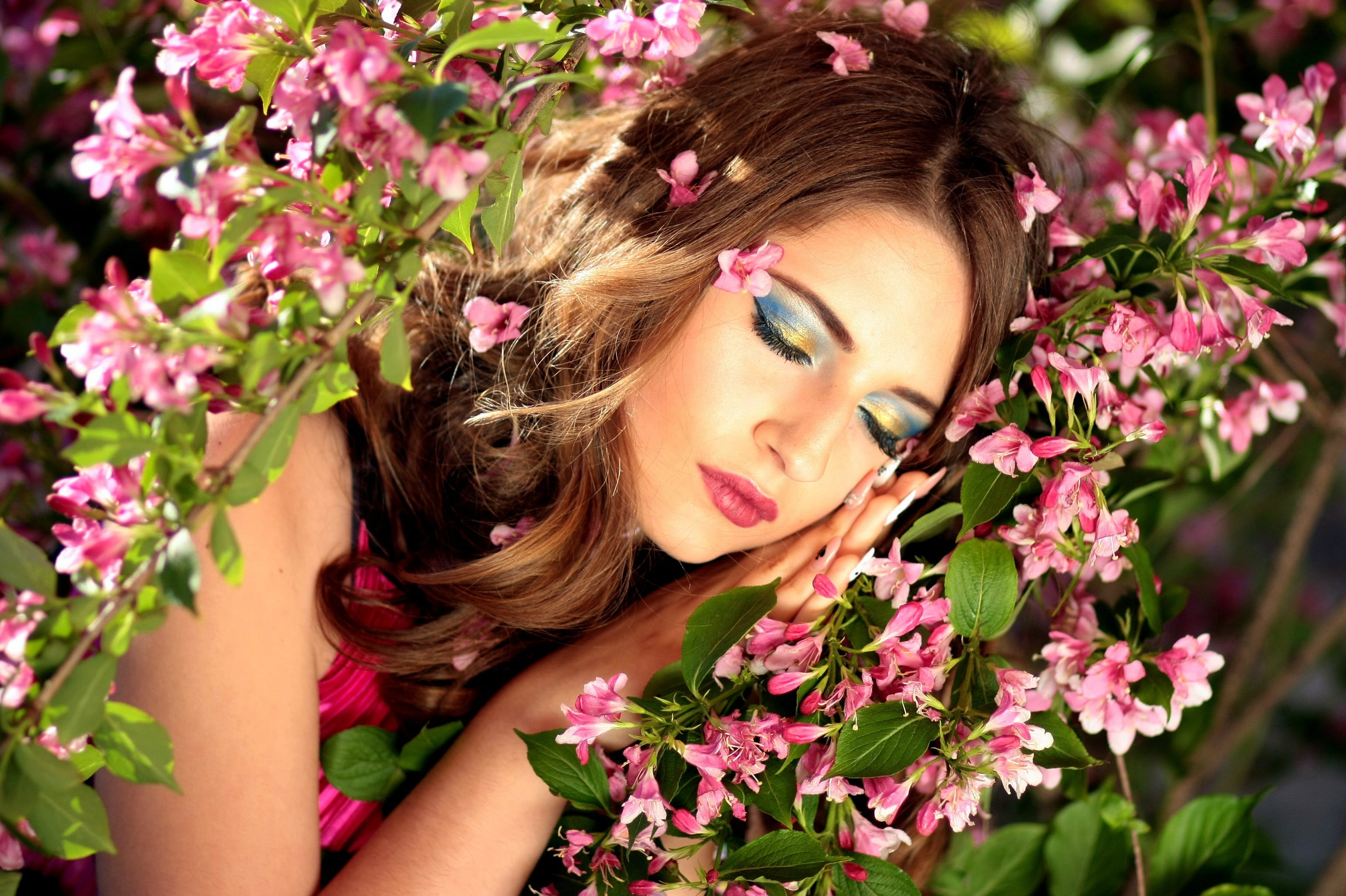 Woman Sleeping on Pink Flowers