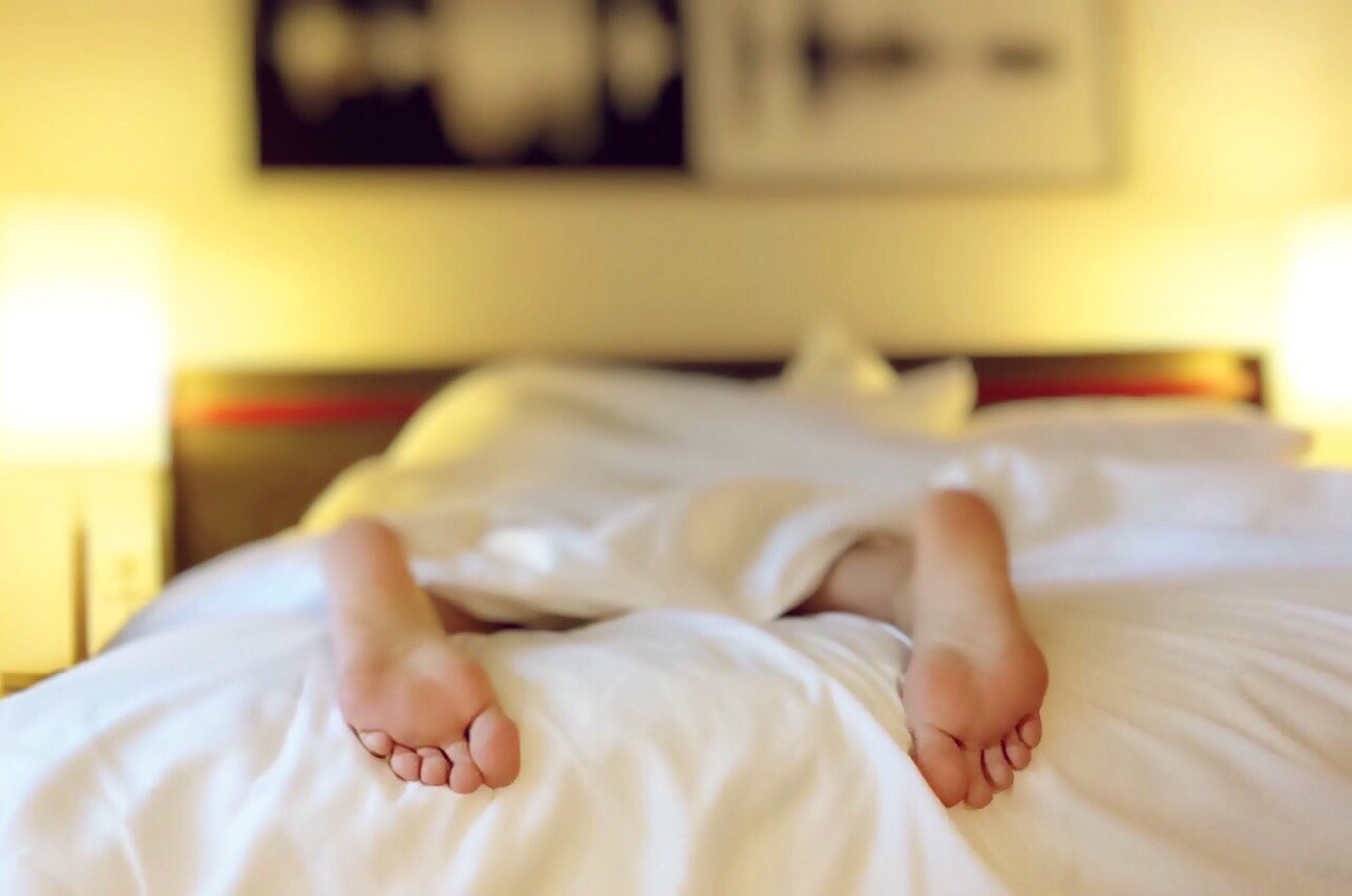 Person Lying on Bed Covering White Blanket · Free Stock Photo