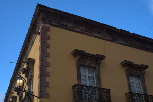 Free stock photo of architectural, blue sky, colonial, yellow