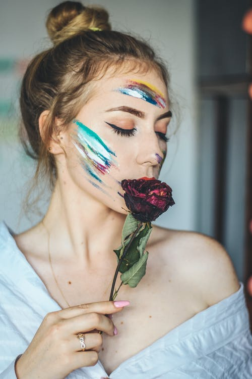Woman Holding Withered Rose
