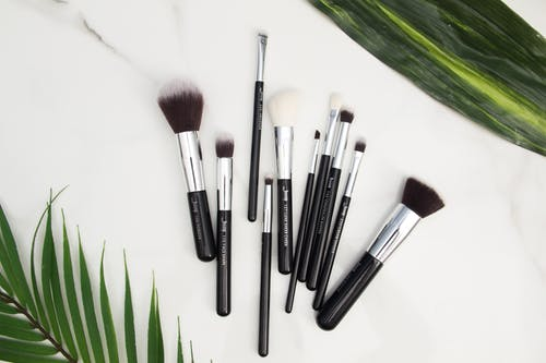 10-piece Black Makeup Brush Set on White Panel