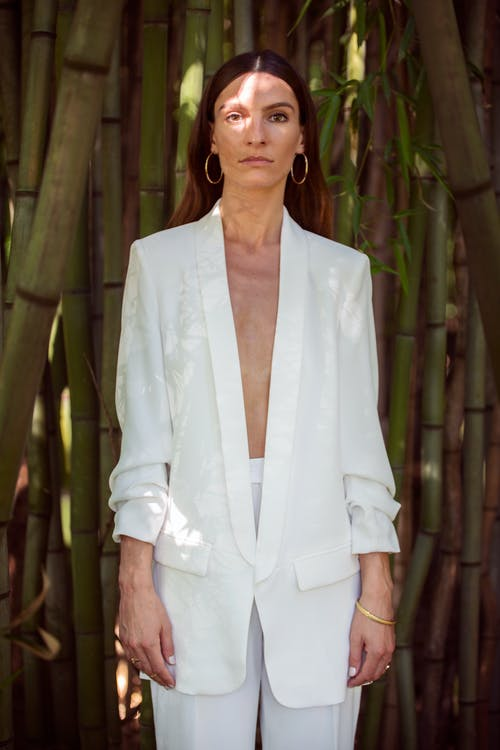 Woman Wearing White Suit Jacket and Pants