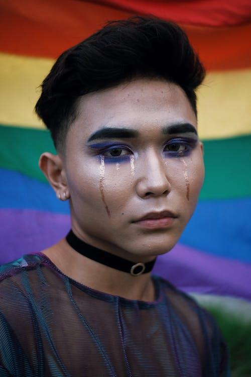 Close-Up Photo of a Man Wearing Make-Up