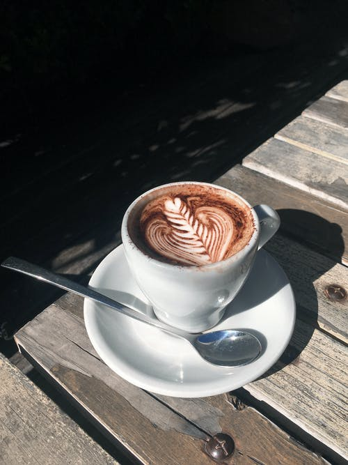 A Cup of Cappuccino on Wooden Table