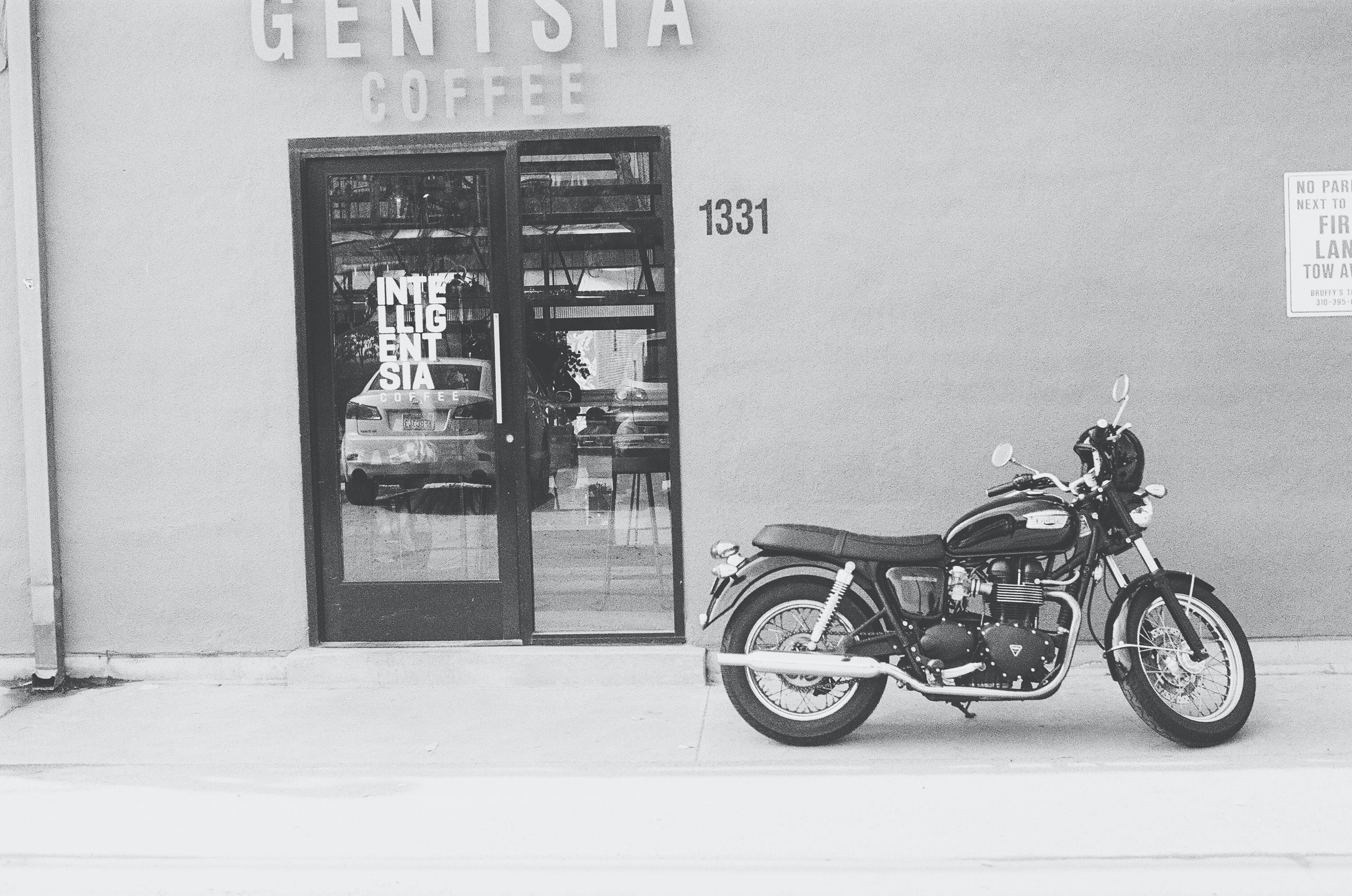Grayscale Photography of Genisia Coffee Shop