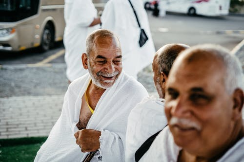 Photo of Men Wearing White Robes