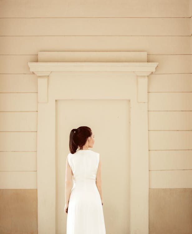 Back View Of Woman In White Sleeveless Dress