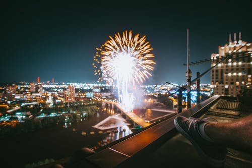 Photo of Person Watching Fireworks During Nighttime