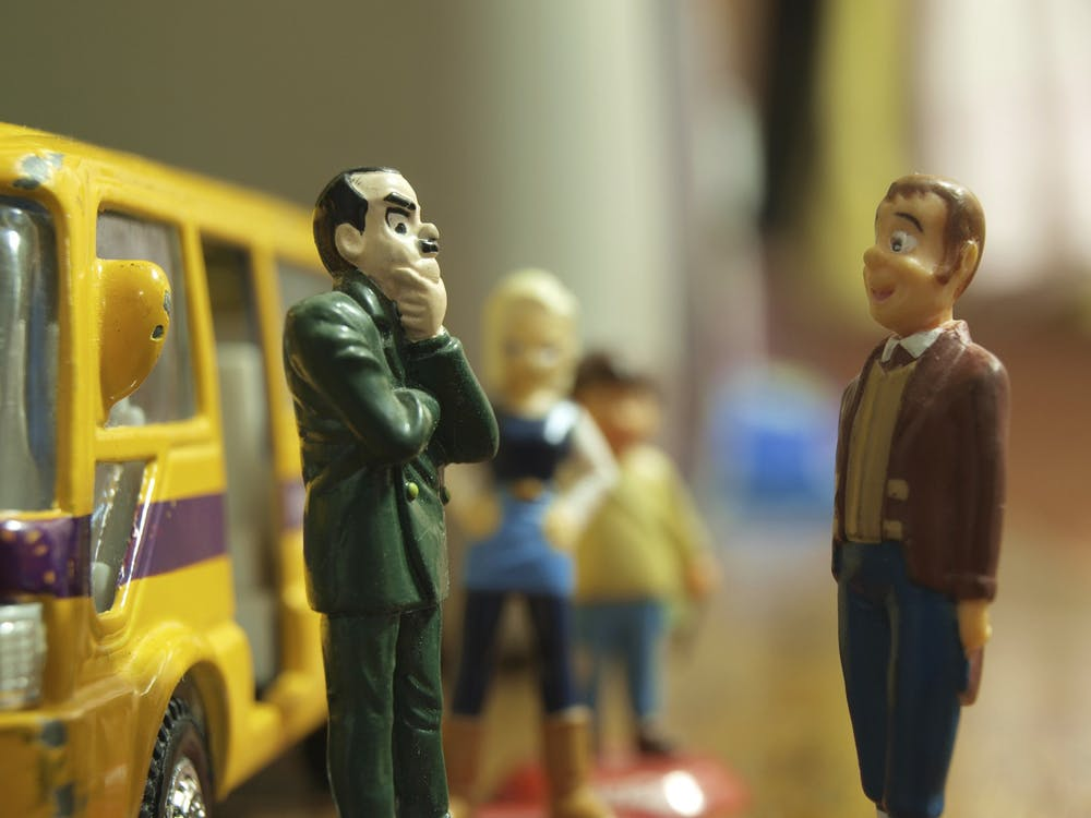 Free stock photo of bus stop, discussion, figures