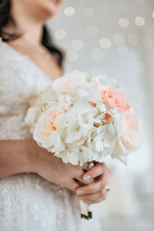 Photo of Woman Holding White Bouquet