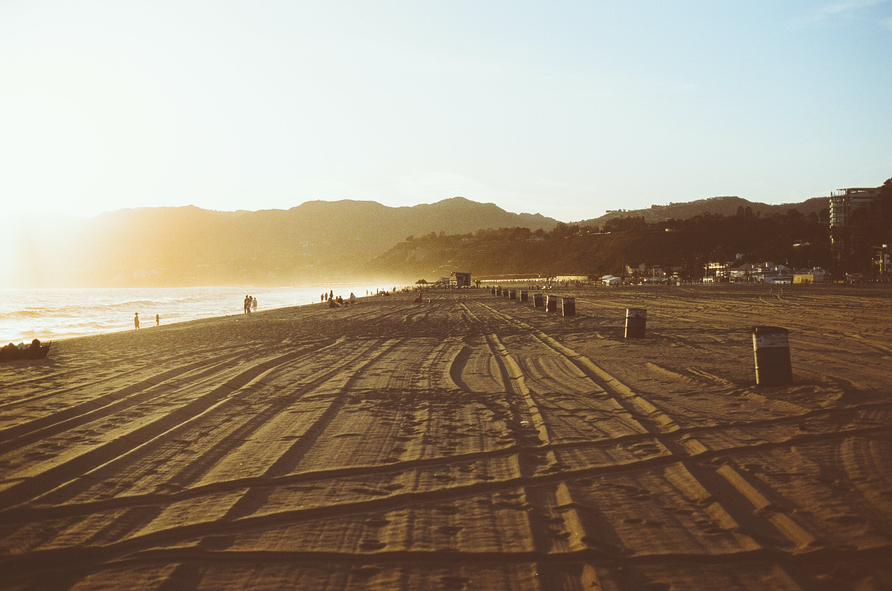 Gratis lagerfoto af solnedgang, spor, strand
