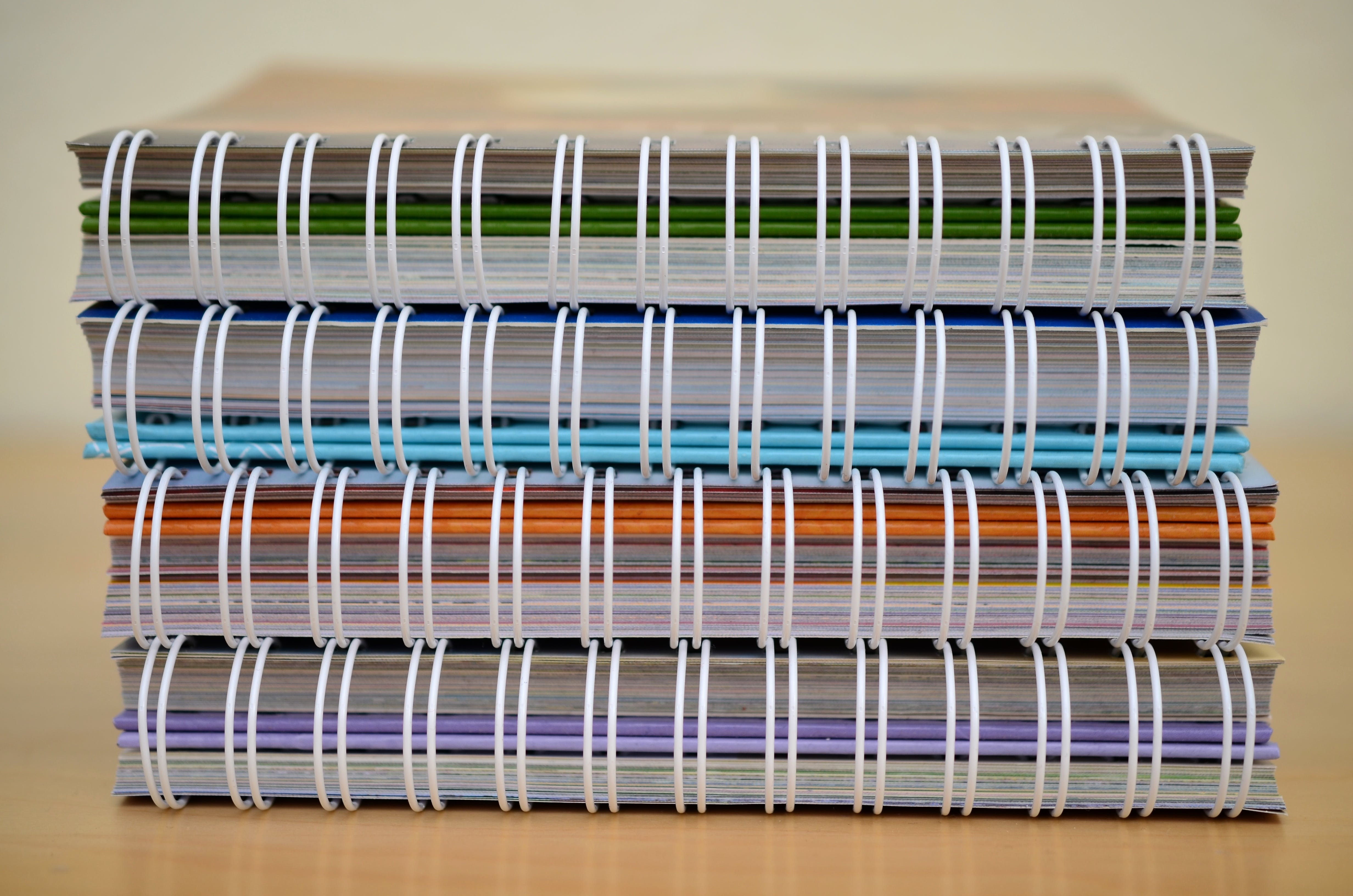 Piled of Spring Notebooks
