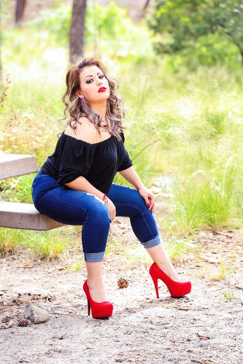 Free stock photo of bbw model, denim pants, plus size model, red heels