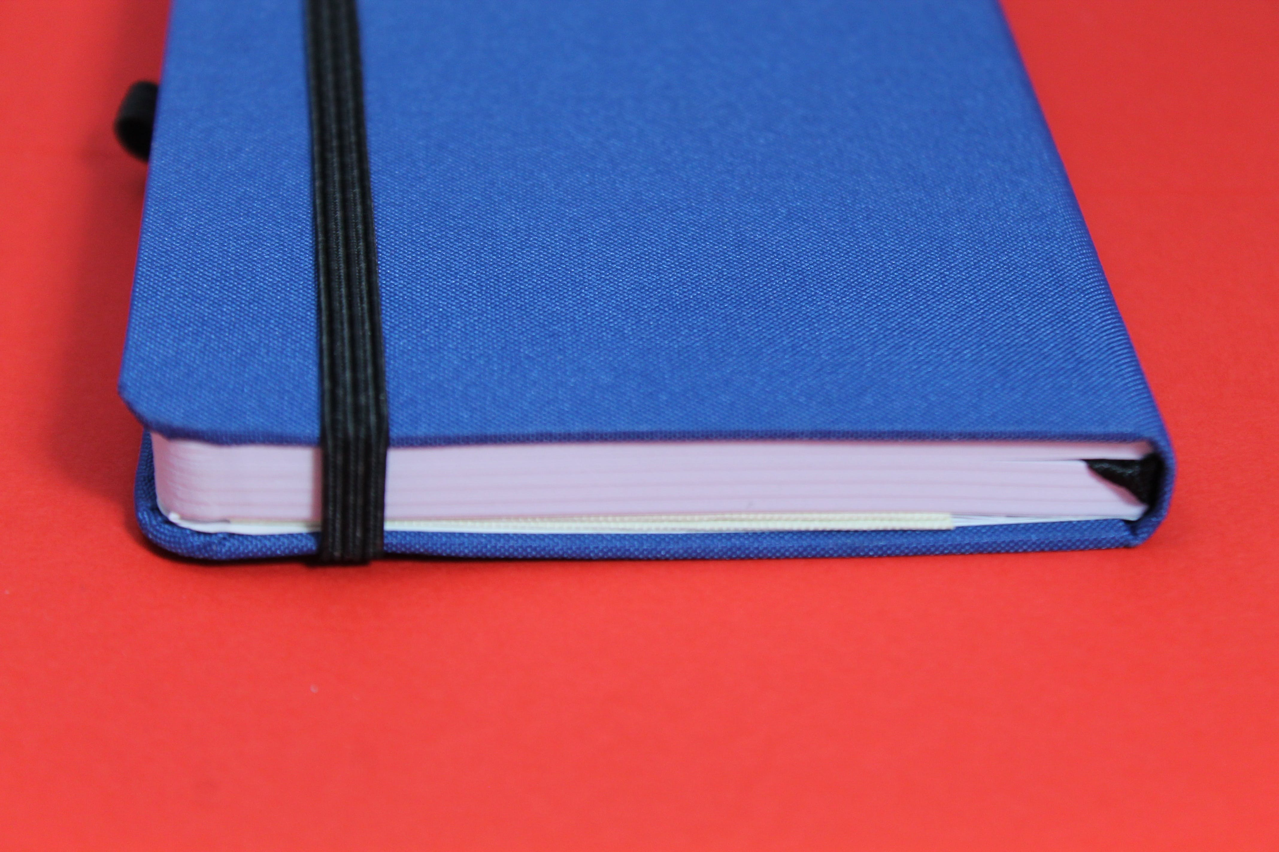 Free stock photo of red, blue, desk, notebook