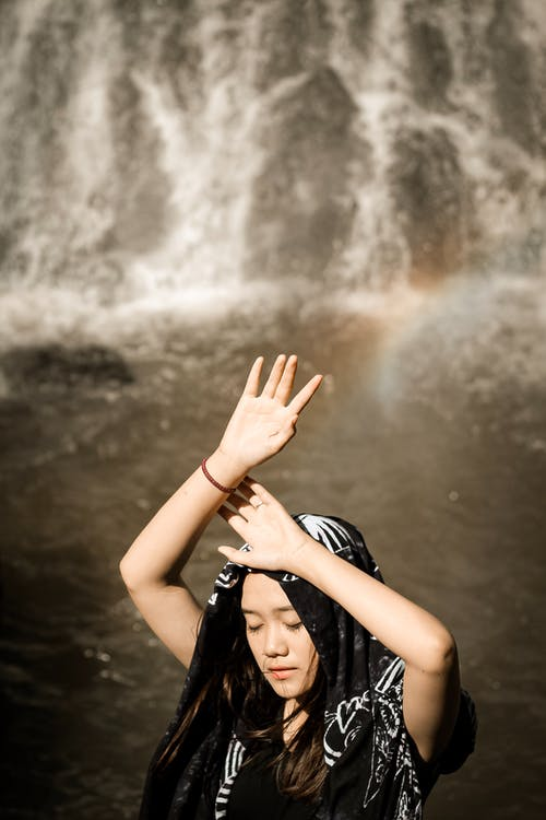Photo Of Woman Raising Her Hands