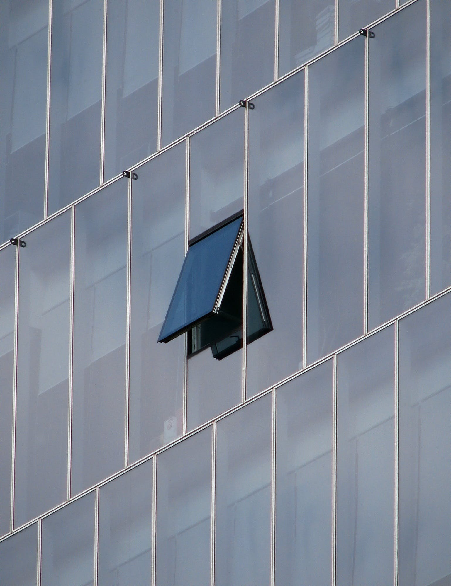 One Open Window on Laminated Glass Building
