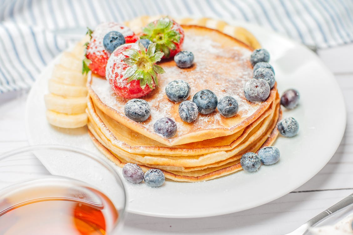 Pancakes With Berries on White Plate