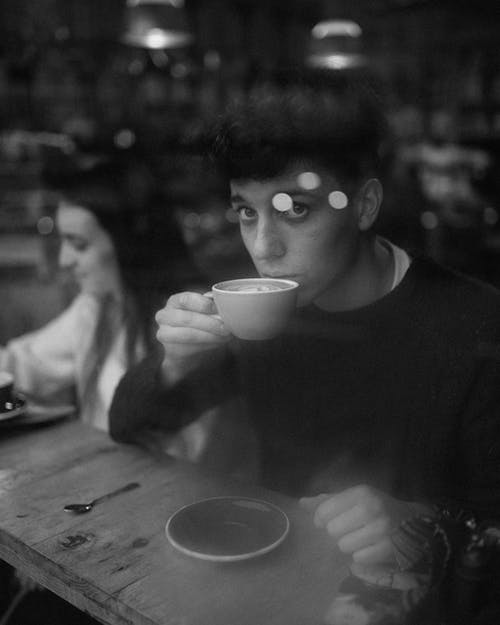 Monochrome Photo of Man Holding Teacup