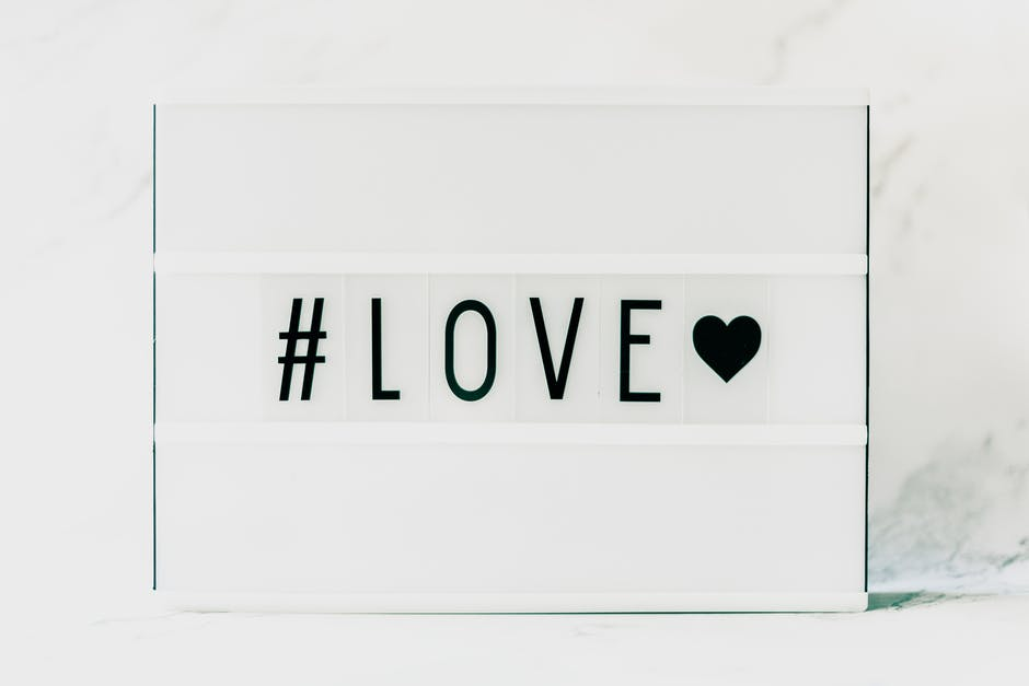 Black love and black heart on white background