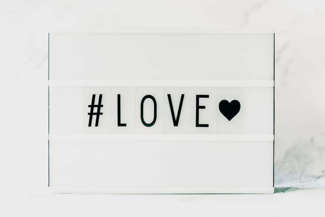 Black #love and Black Heart on White Background