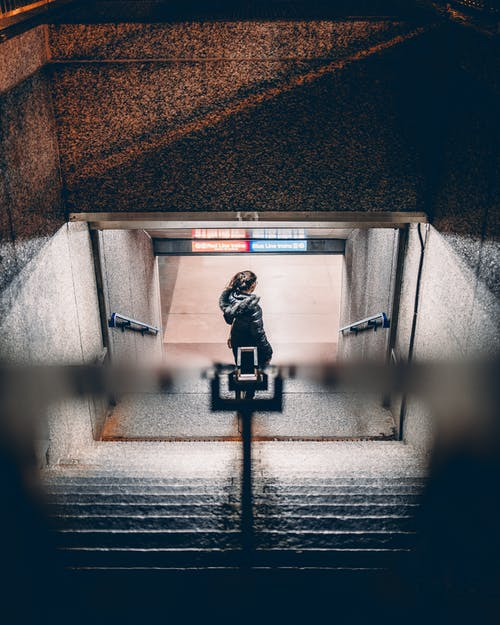 Photo of a Woman Walking on Stairs