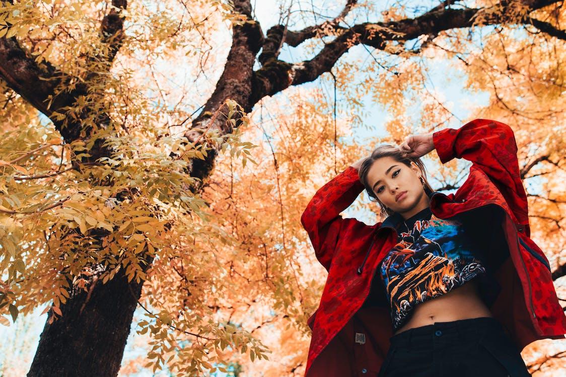 Low-Angle Photo of Woman Standing Near Tree