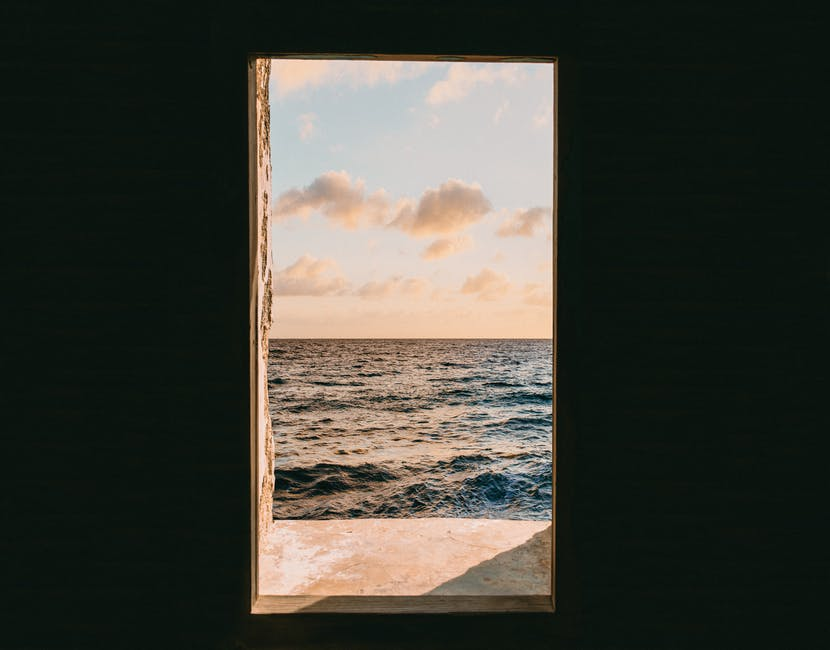 Window view of sea during golden hour
