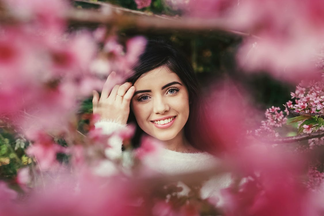 Photo of Woman Surrounded With Pink Flowers