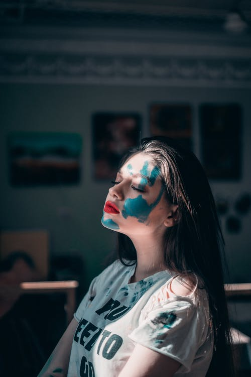 Woman With Blue Paint on Her Face