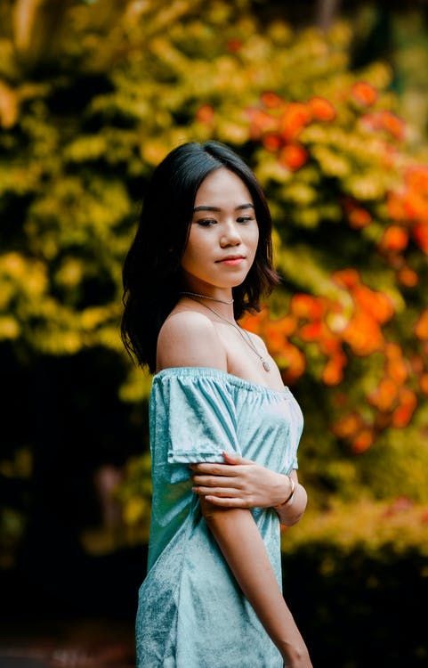 Women's Teal Strapless Dress Close-up Photography