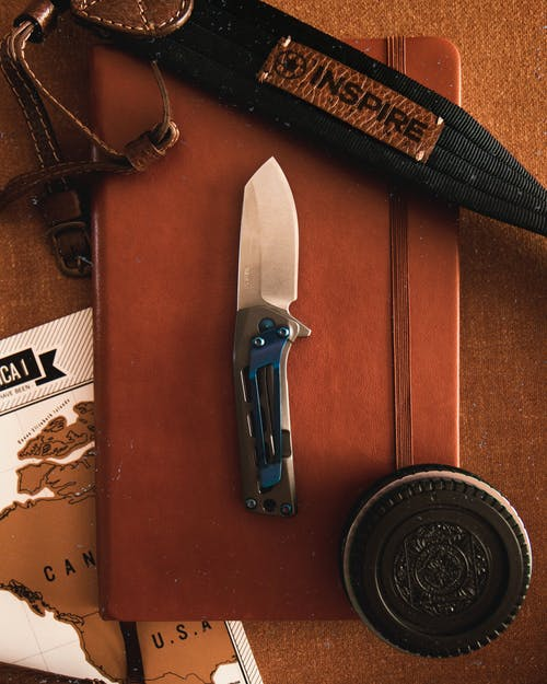 Pocket Knife, Cookie Sandwich, Black Leather Sheath on Brown Leather Flip Case
