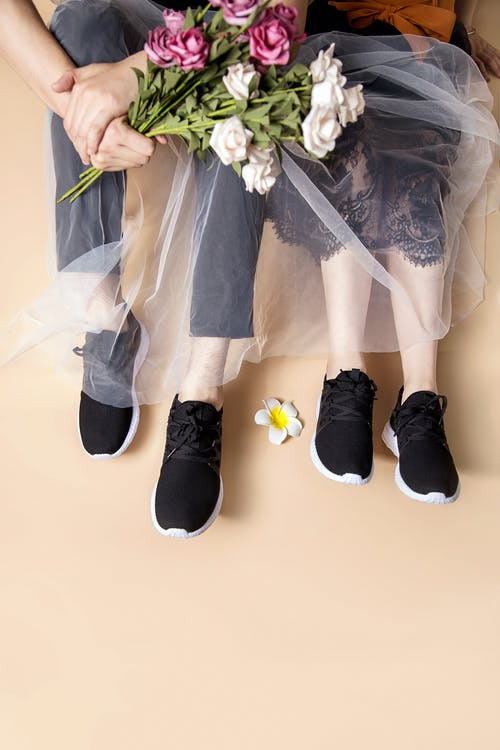 Couple Wearing The Same Black Shoes