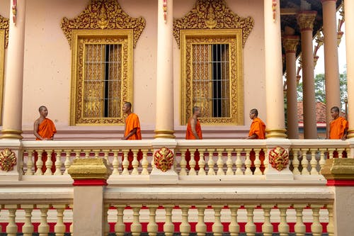 Monks Standing on Porch