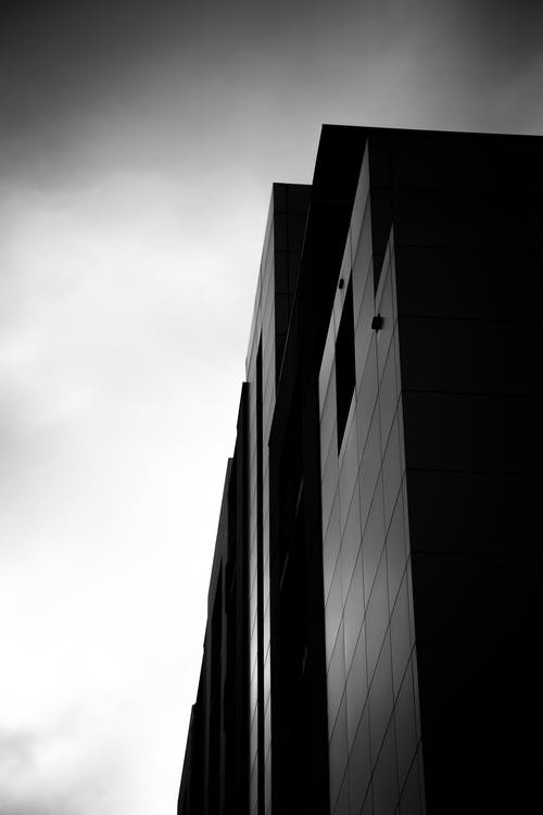 Grayscale Photograph of High-rise Building