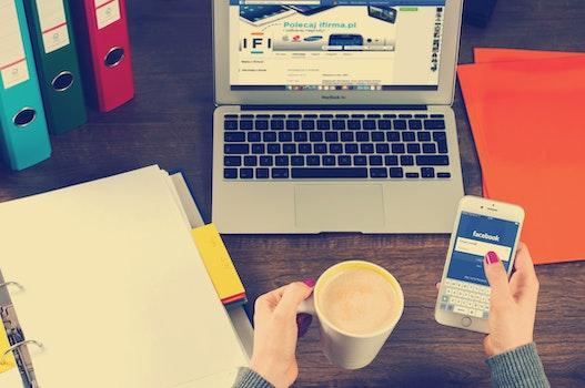 Free stock photo of woman, coffee, smartphone, desk