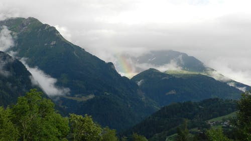 Rainbow in between Mountains