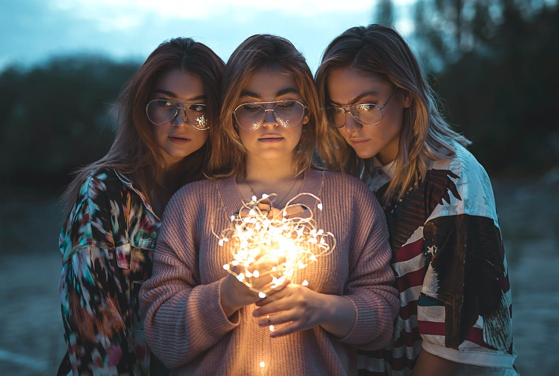 Photo of Three Women Wearing Eyeglasses