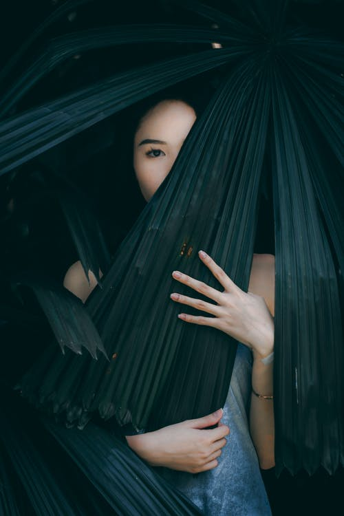 Woman With Leaves Covering Her Face