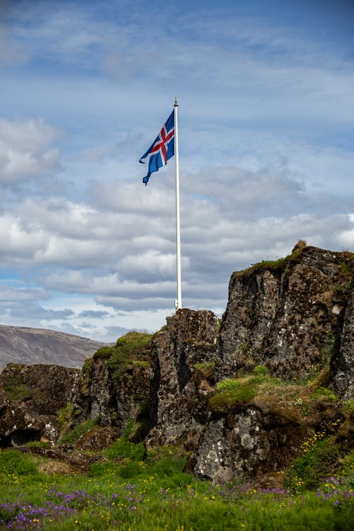 Flag Of Iceland On A Mountain