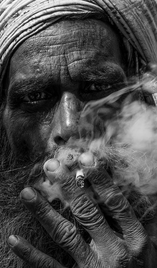Old Man Smoking Cigarette