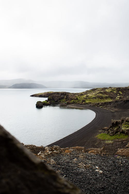 View Of An Island's Shore With Black Sand
