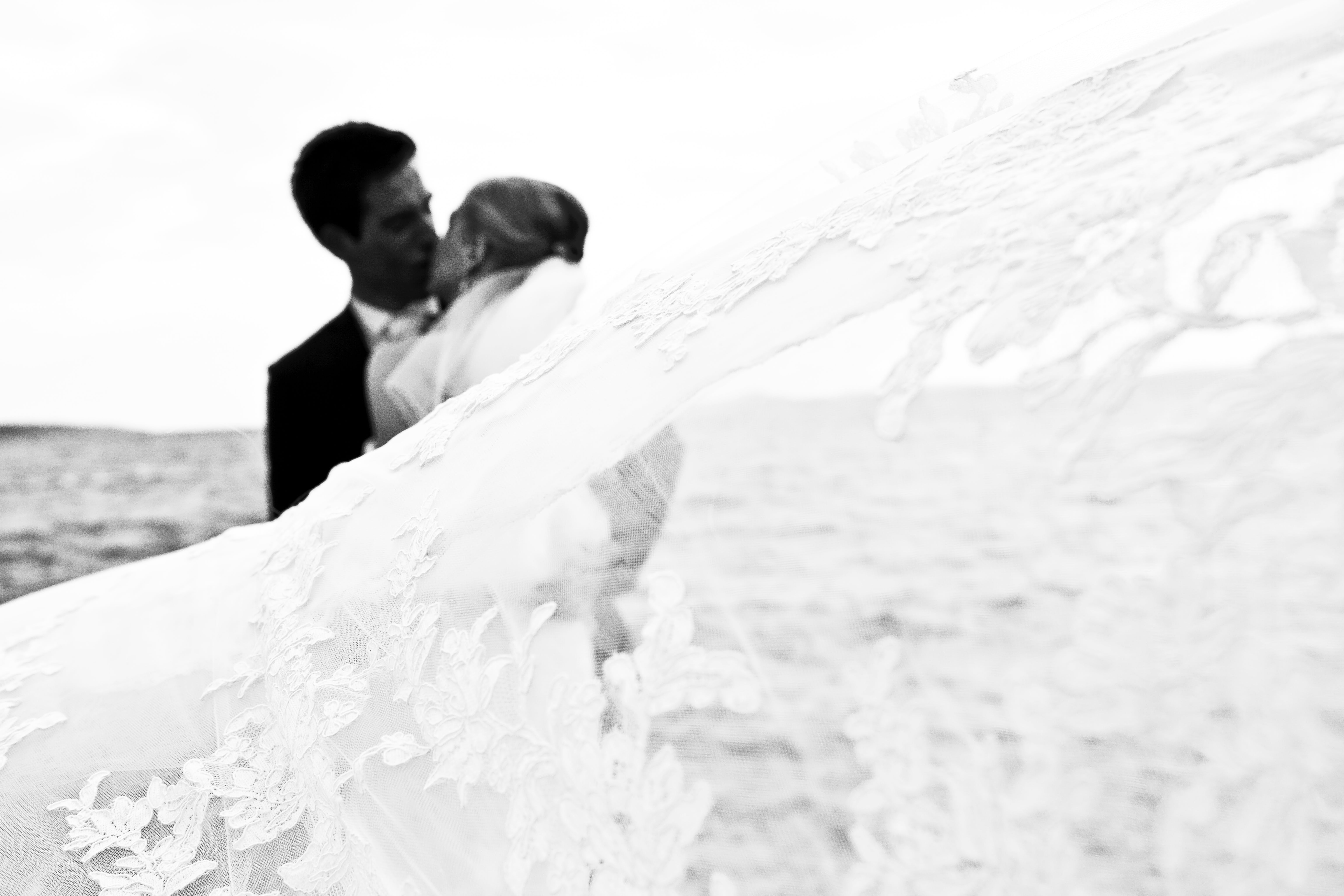 Grayscale Photography of Kissing Newly Wed