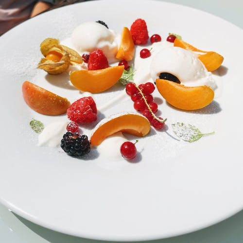 Sliced Fruits on White Ceramic Plate