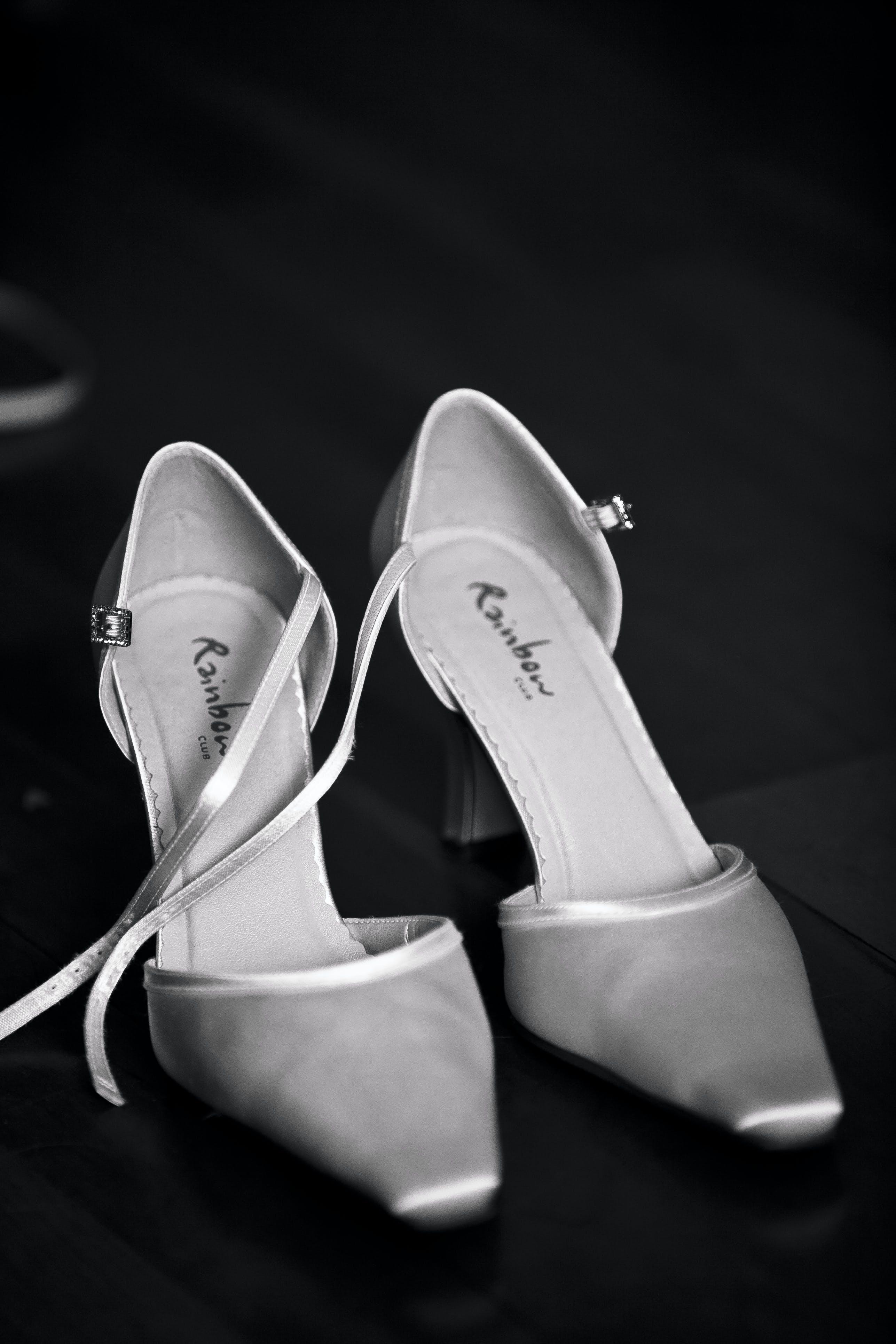 Gray Rainbow Heeled Sandals on Black Surface